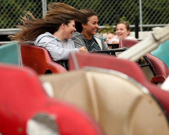 Skylar Wilson 19, (left) and Riley Burns, 19, both of Kingston, laugh as they ride the Sizzler at the Kitsap County Fair & Stampede on Saturday, August 25. 2018.