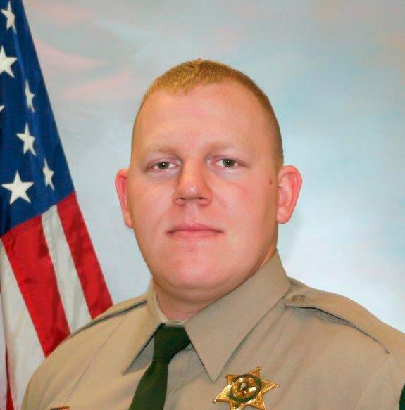 Officers fatally shoot suspect in death of Washington deputy