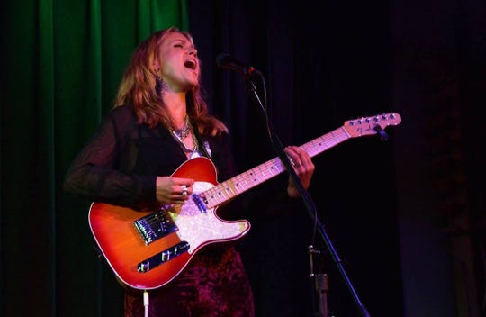 AnneMarie Kelbon rocks out during a 2016 gig.