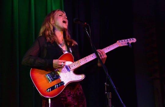 AnneMarie Kelbon rocks out during a 2016 gig.