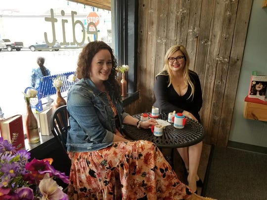 Elise (left) and Geneva Lee have a tea party at Away with Words in Poulsbo.