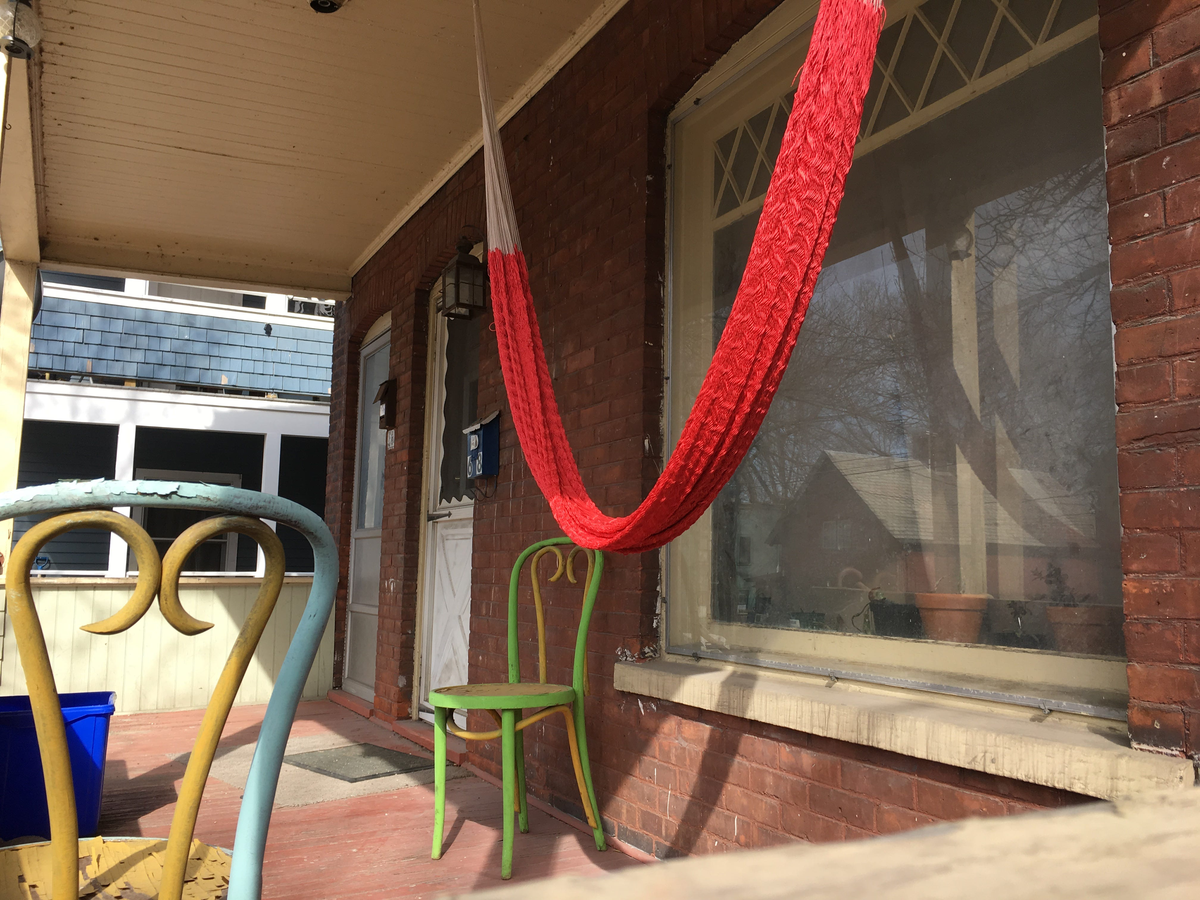 A hammock joins a pair of chairs on a King Street porch in Burlington on Sunday, April 14, 2019.