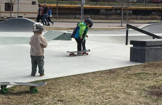 Youngsters prepare to skateboard along the Burlington waterfront on Sunday, April 14, 2019.