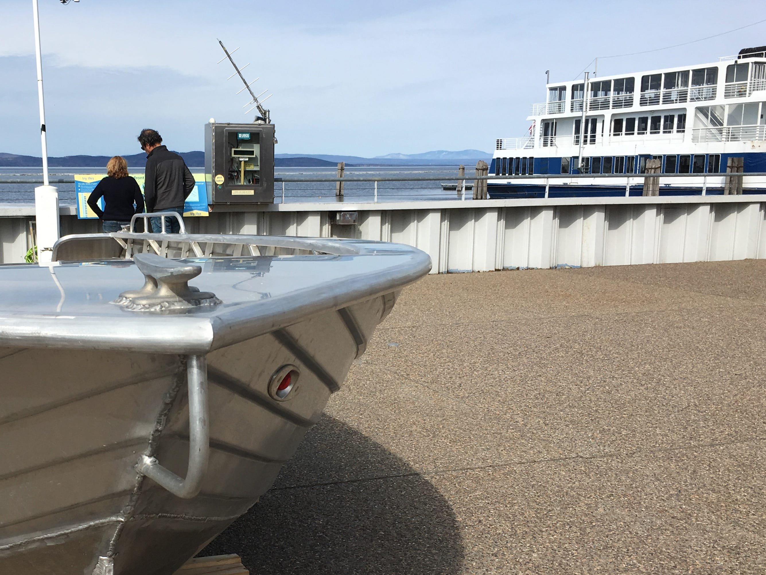 Visitors to the ECHO dock in Burlington study a lake-level chart on Sunday, April 14, 2019.