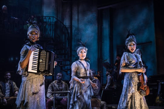 "The Fates are portrayed by Jewelle Blackman, Yvette Gonzalez-Nacer and Kay Trinidad in the Broadway production of Anais Mitchell's musical ""Hadestown."""