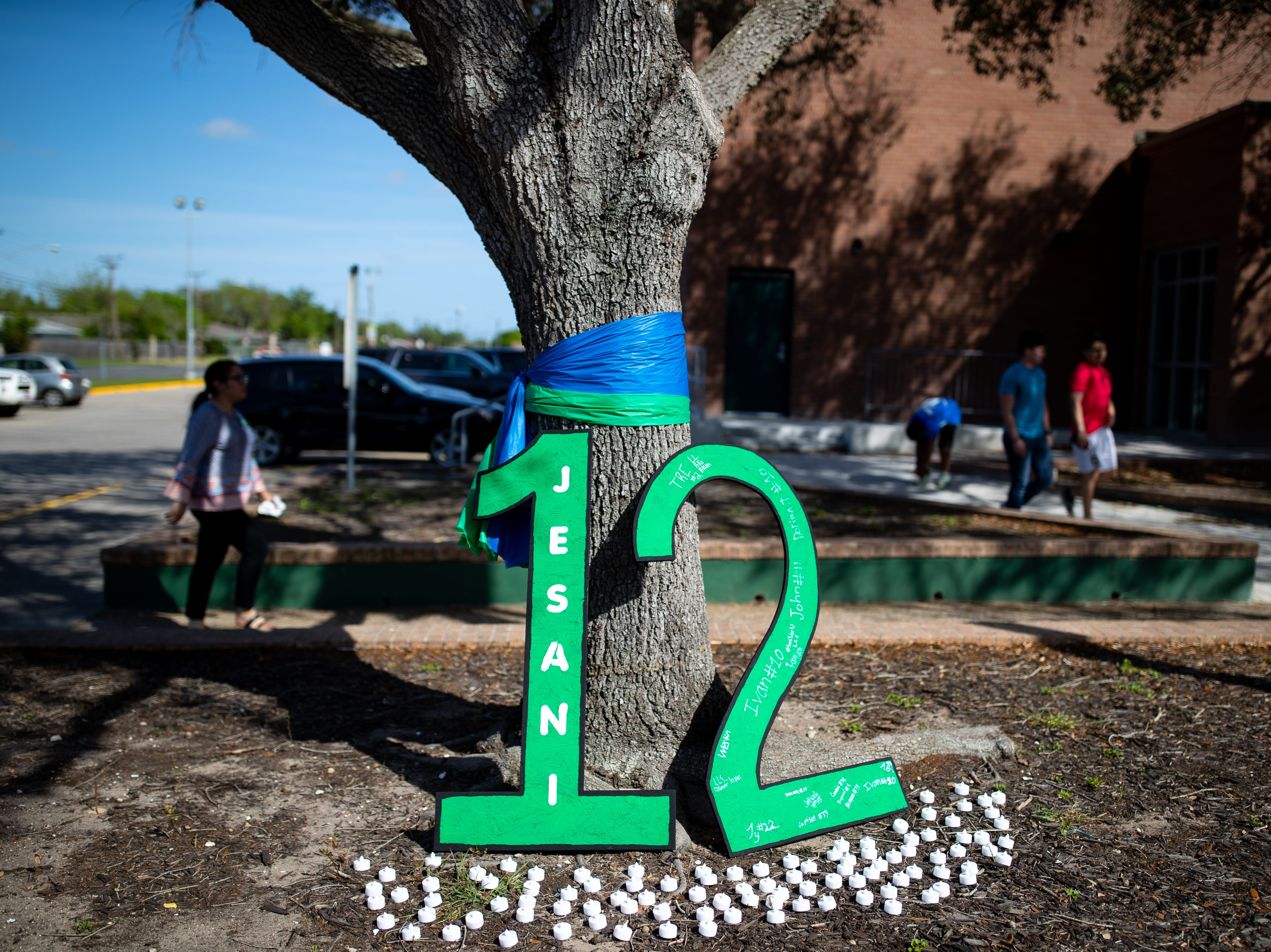 A big 12 sits in front of King High School to honor senior Je'Sani Smith on Monday, April 15, 2019. Je'Sani Smith's body was recovered Sunday afternoon near Bob Hall Pier after drowning on Whitecap Beach last week.