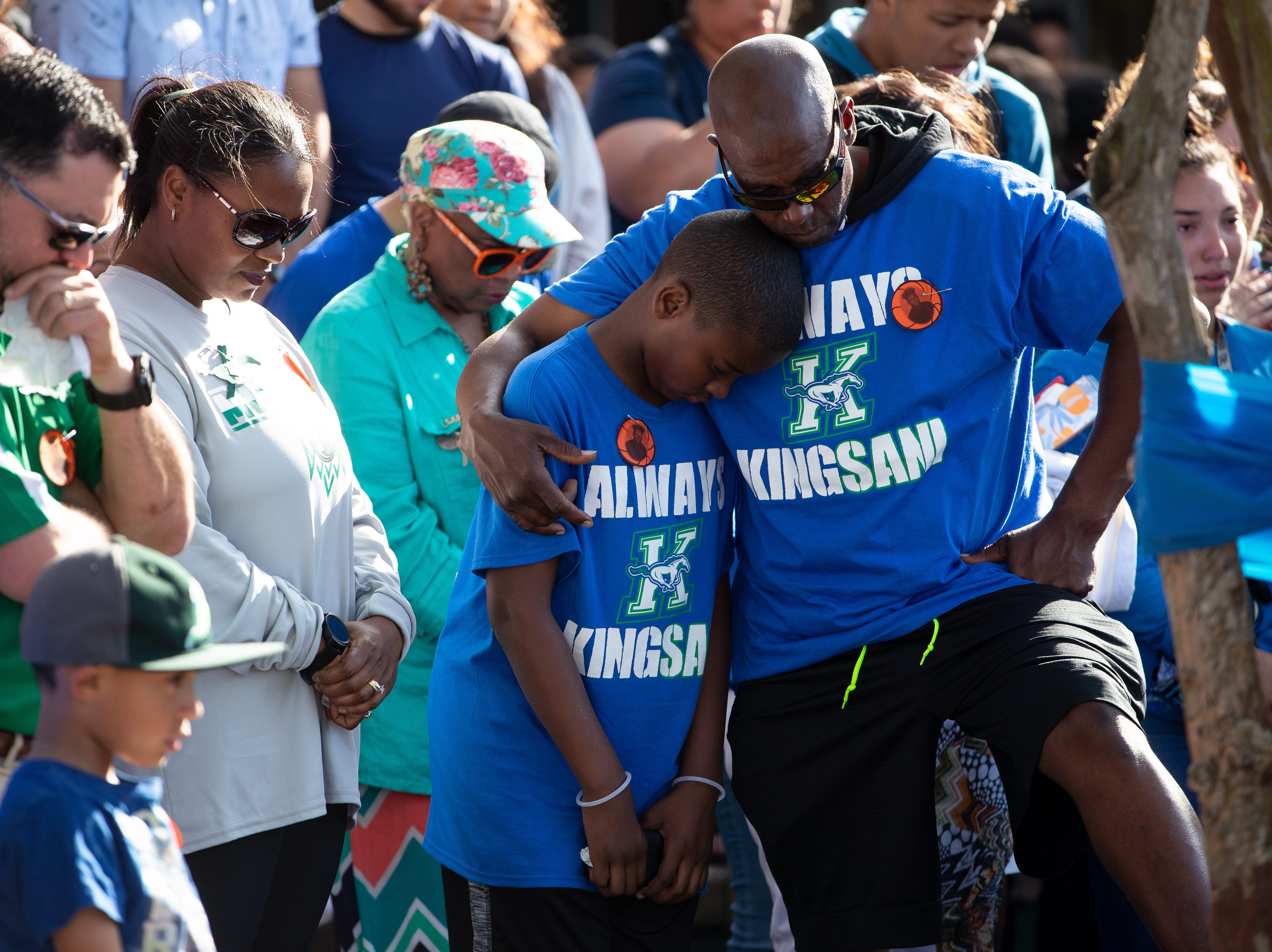 King High School senior Je'Sani Smith's father Terrance Denson and younger brother Terrance embrace during a vigil remembering Je'Sani on Monday, April 15, 2019. Je'Sani Smith's body was recovered Sunday afternoon near Bob Hall Pier after drowning on Whitecap Beach last week.