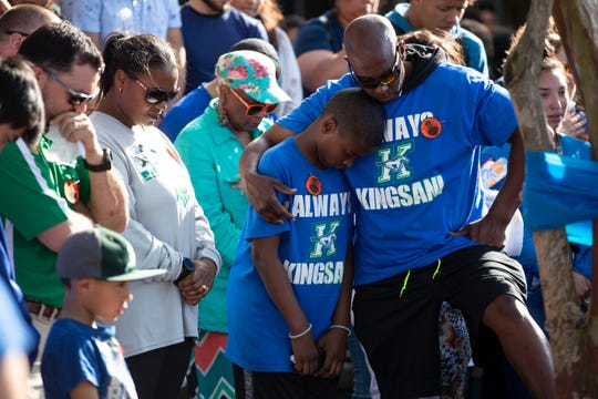 King High School senior Je'Sani Smith's father Terrance Denson and younger brother Terrance Jr. embrace during a vigil remembering Je'Sani on Monday, April 15, 2019. Je'Sani Smith's body was recovered Sunday afternoon near Bob Hall Pier after drowning on Whitecap Beach last week.