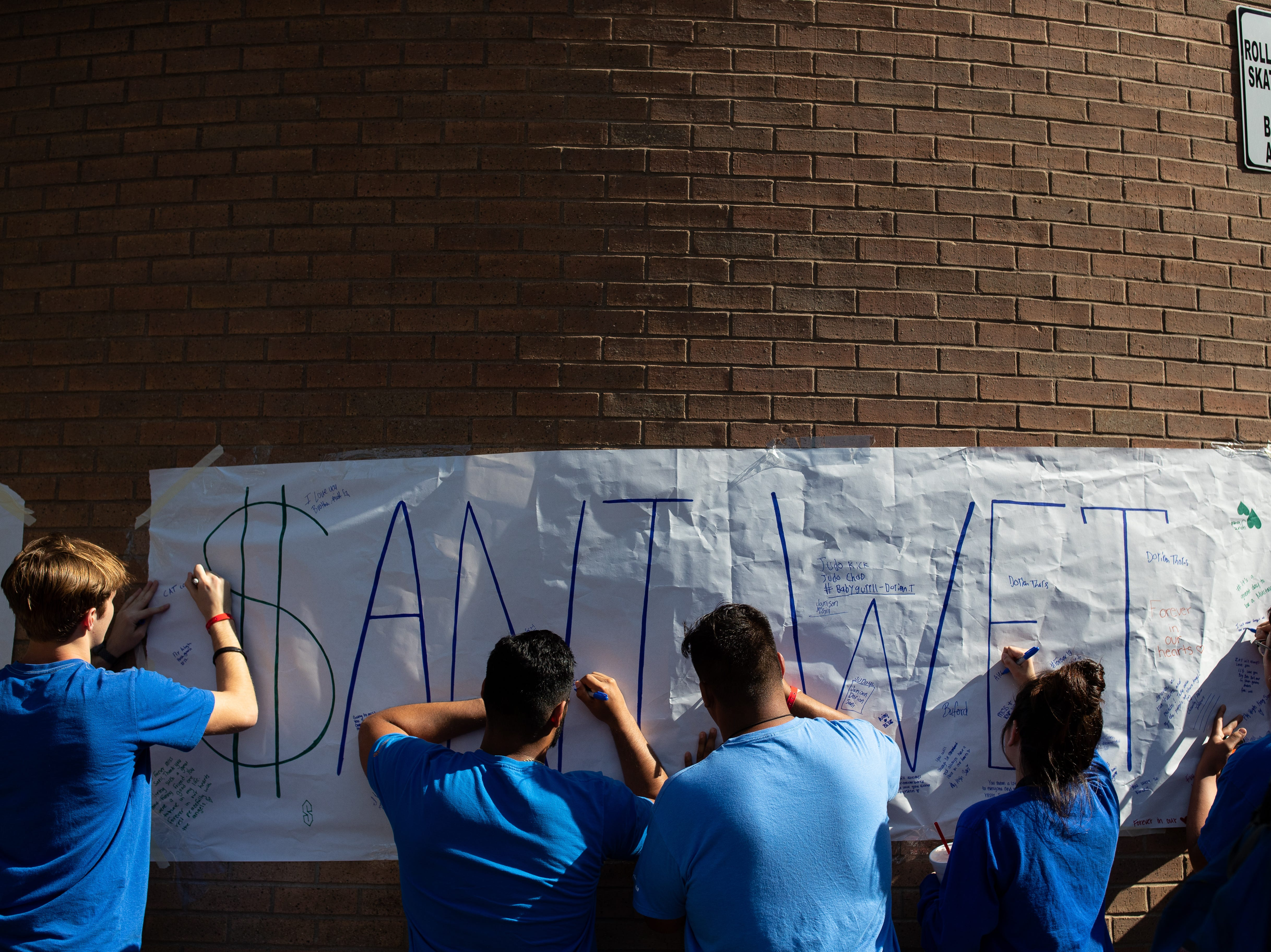 King High School students sign a banner outside the school to honor senior Je'Sani Smith on Monday, April 15, 2019. Je'Sani Smith's body was recovered Sunday afternoon near Bob Hall Pier after drowning on Whitecap Beach last week.