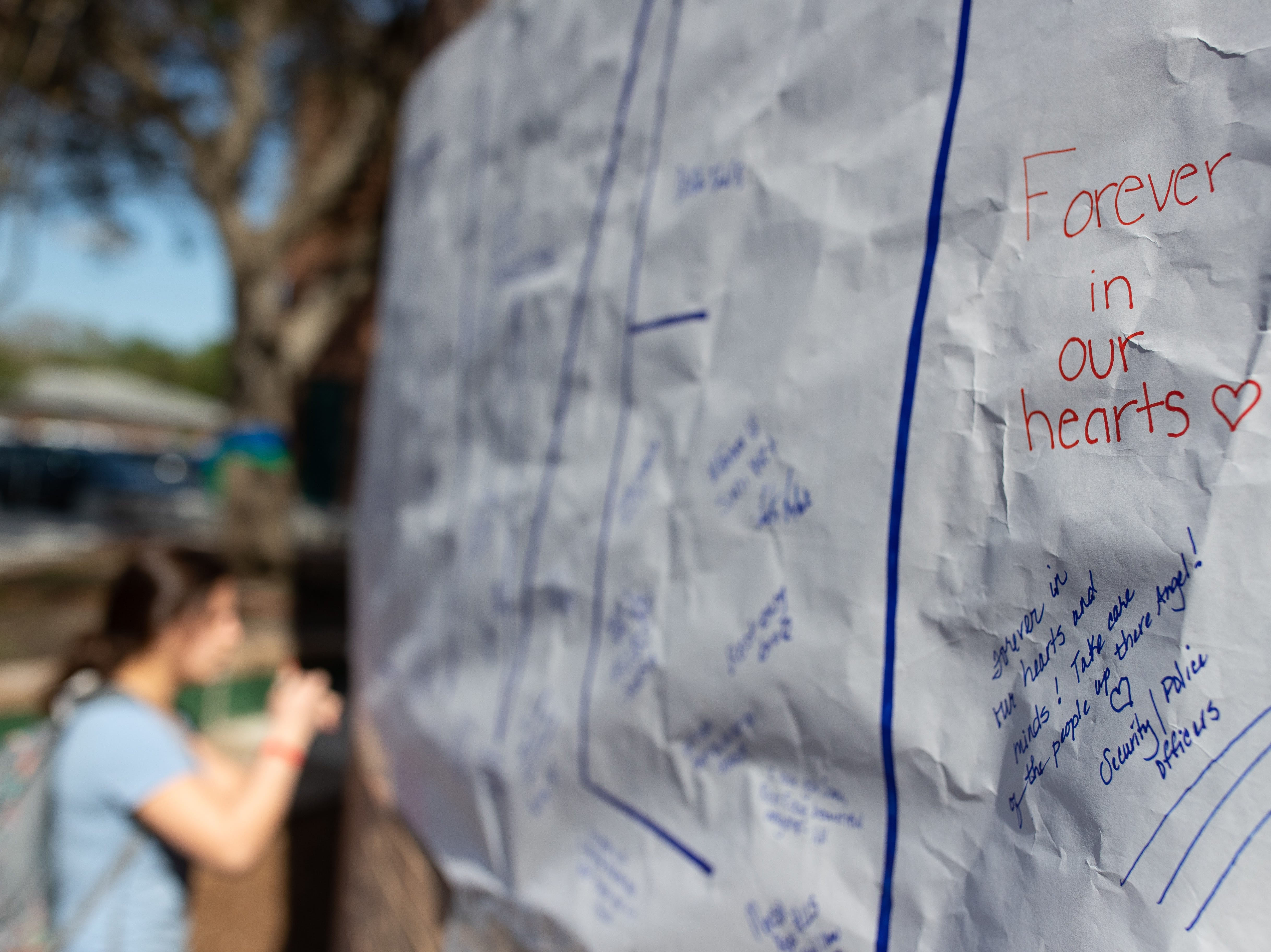 King High School students right notes on a banner outside the school to honor senior Je'Sani Smith on Monday, April 15, 2019. Je'Sani Smith's body was recovered Sunday afternoon near Bob Hall Pier after drowning on Whitecap Beach last week.