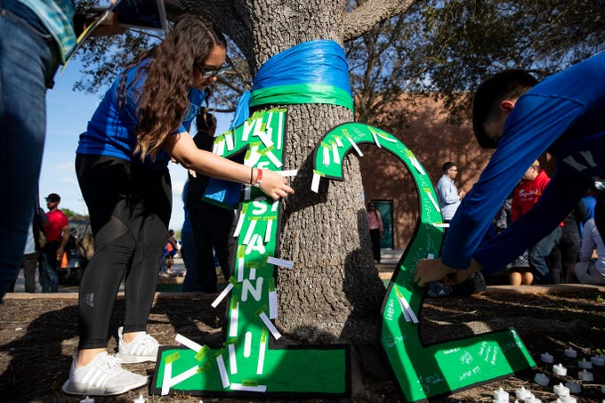 King High School students place notes on a large 12 outside the school to honor senior Je'Sani Smith following a vigil for him on Monday, April 15, 2019. Je'Sani Smith's body was recovered Sunday afternoon near Bob Hall Pier after drowning on Whitecap Beach last week.