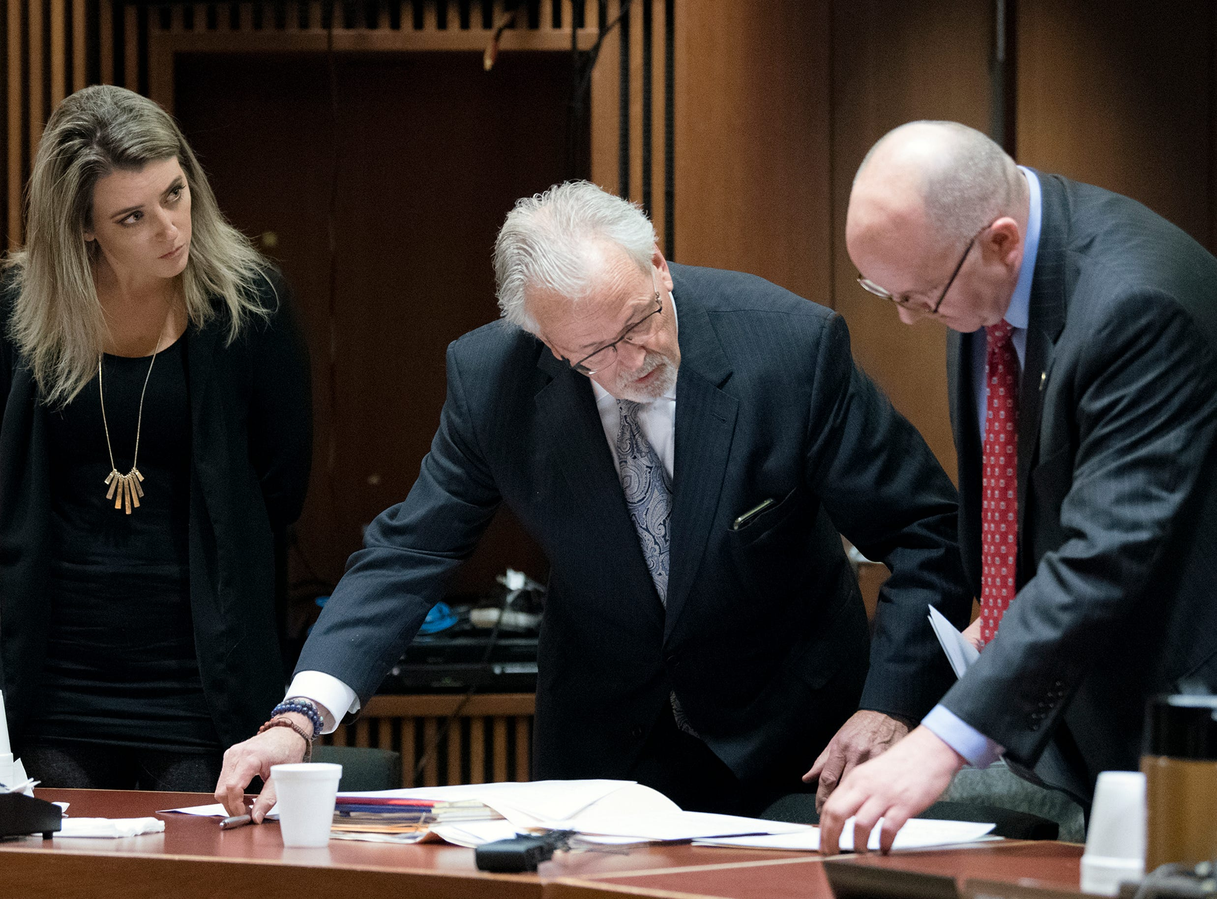 Kate McClure, from left, appears in court alongside her attorney James Gerrow and prosecutor Andrew McDonnell Monday, April 15, 2019 at Burlington County Superior Court in Mount Holly, N.J. McClure pleaded guilty to a state charge in a 'good Samaritan' scam of GoFundMe donors and faces four years in jail.
