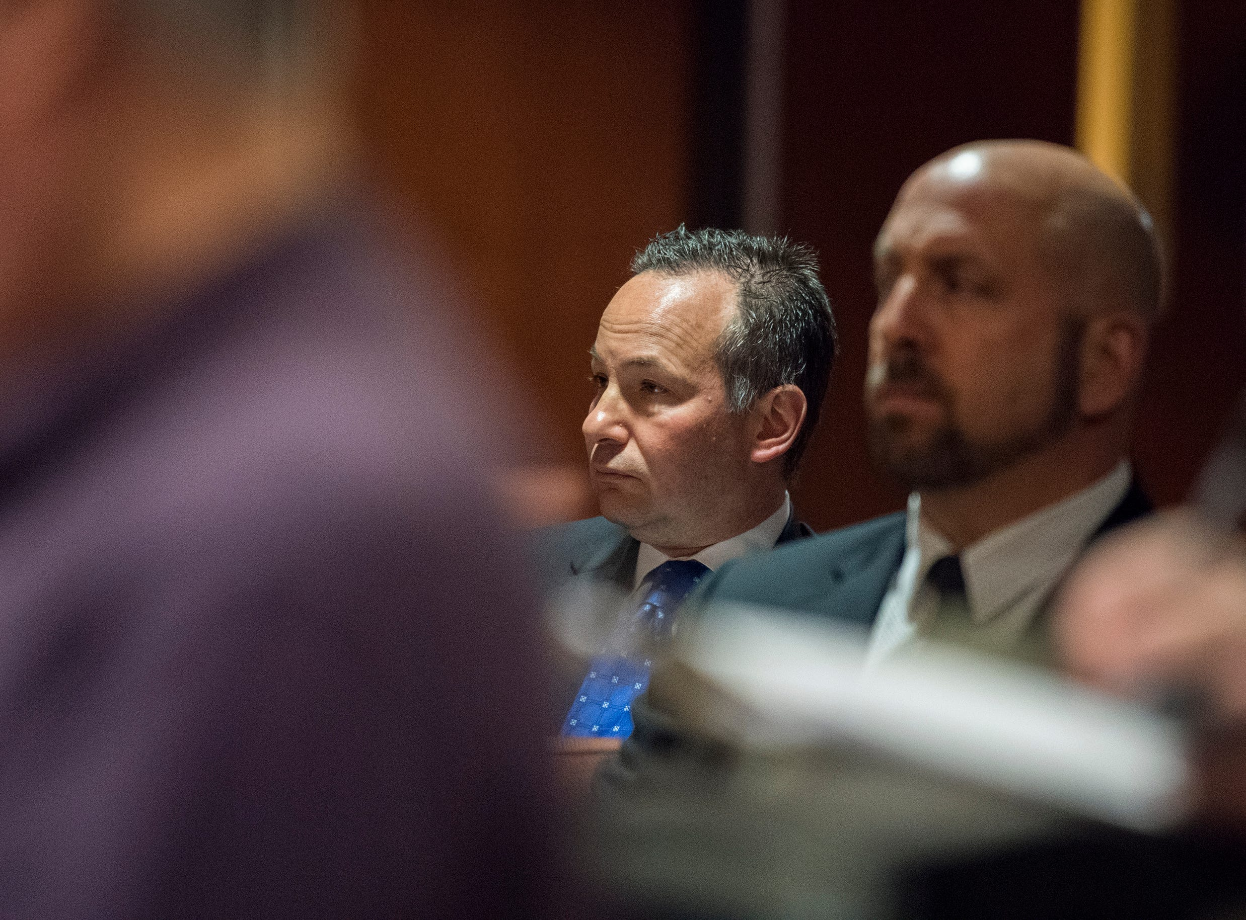 Burlington County Prosecutor Scott Coffina watches from the gallery as Kate McClure appears in court Monday, April 15, 2019 in Mount Holly, N.J. McClure pleaded guilty to a state charge in a 'good Samaritan' scam of GoFundMe donors and faces four years in jail.