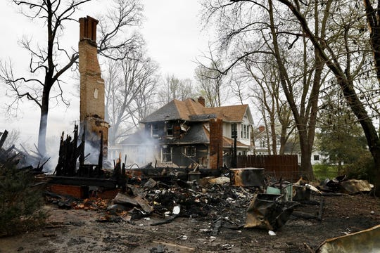 Fire destroyed the home at 4 Highland Ave. and damaged the neighboring home late Sunday night into early Monday morning.