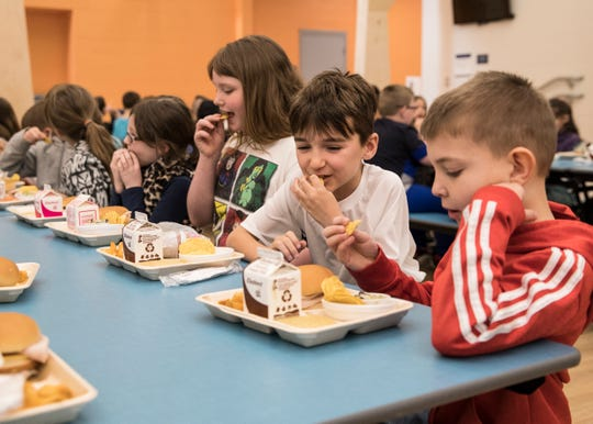 Second-grader William Lawson, second from right, enjoys the Chicken Dip served to him and several of his classmates during lunch as part of the STEM curriculum at Chillicothe Primary School Monday morning.