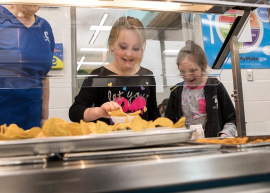 Recipe creators Samantha Bryan and Isabella Routte excitedly go through the lunch line at Chillicothe Primary School as their special Science, Technology, Engineering and Math (STEM) food project was served to all students at the school during lunch time. The STEM students will be traveling to Columbus on May 8 to share their project to a panel of judges for the statewide Battelle Challenge.