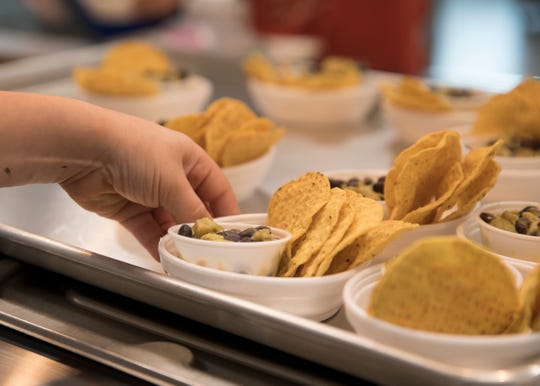Tortillas served with a special chicken dip were given to students at Chillicothe Primary School Monday morning. The dip is an example of a STEM project that focused on how to make healthy diets more available to low income families.  The dip consisted of black beans, chicken, sour cream and avocado. The original recipe called for green peppers instead of chips.