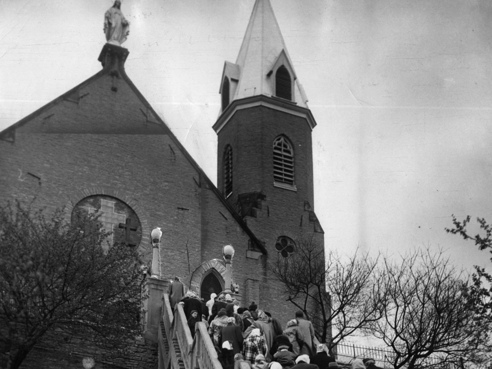 APRIL 1949: People pray the steps on Good Friday at Immaculata Church in Mount Adams.