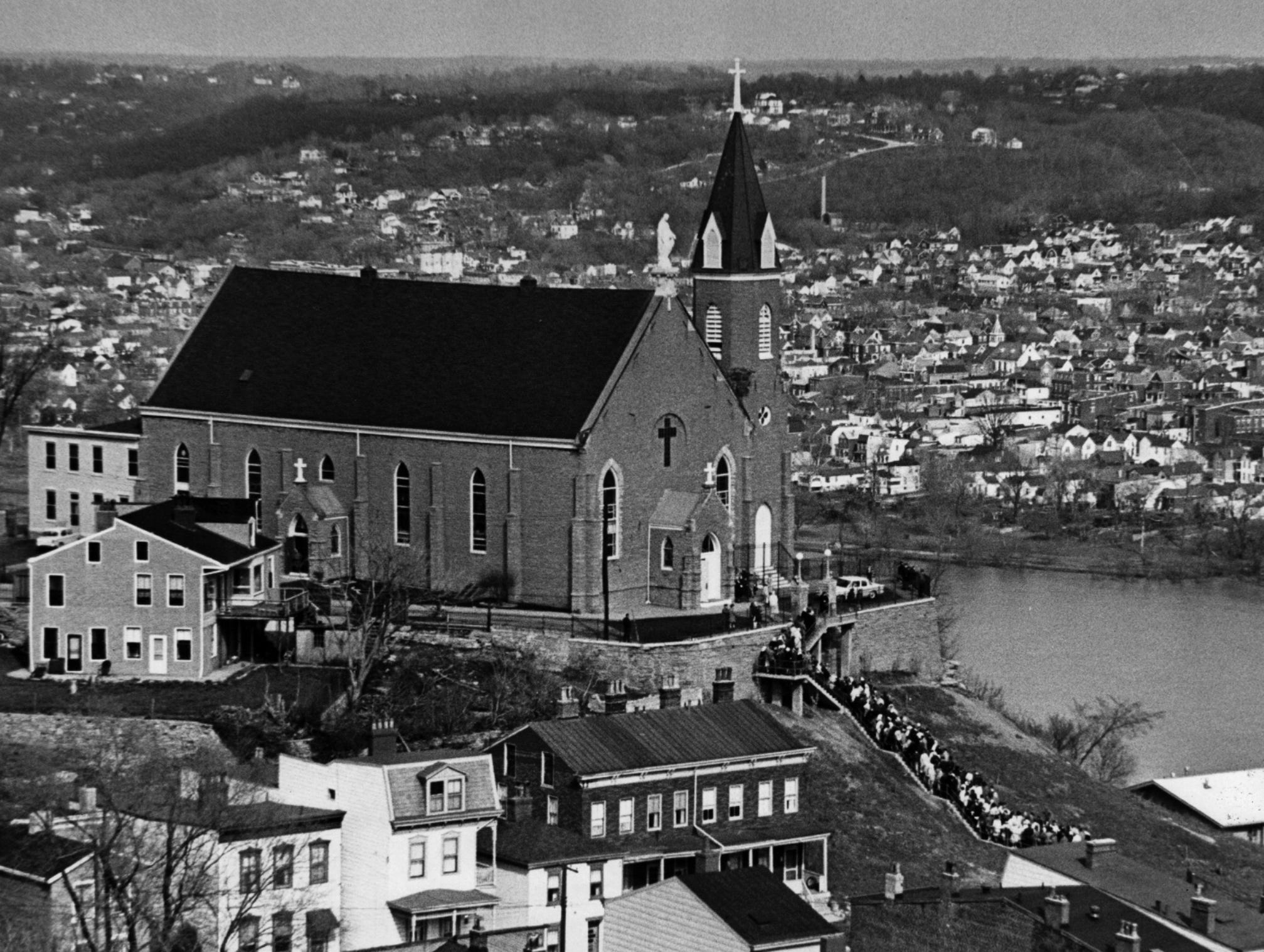 1965: The faithful make their annual Good Friday pilgrimage as they pray the step to Holly Cross-Immaculata Church in Mount Adams.