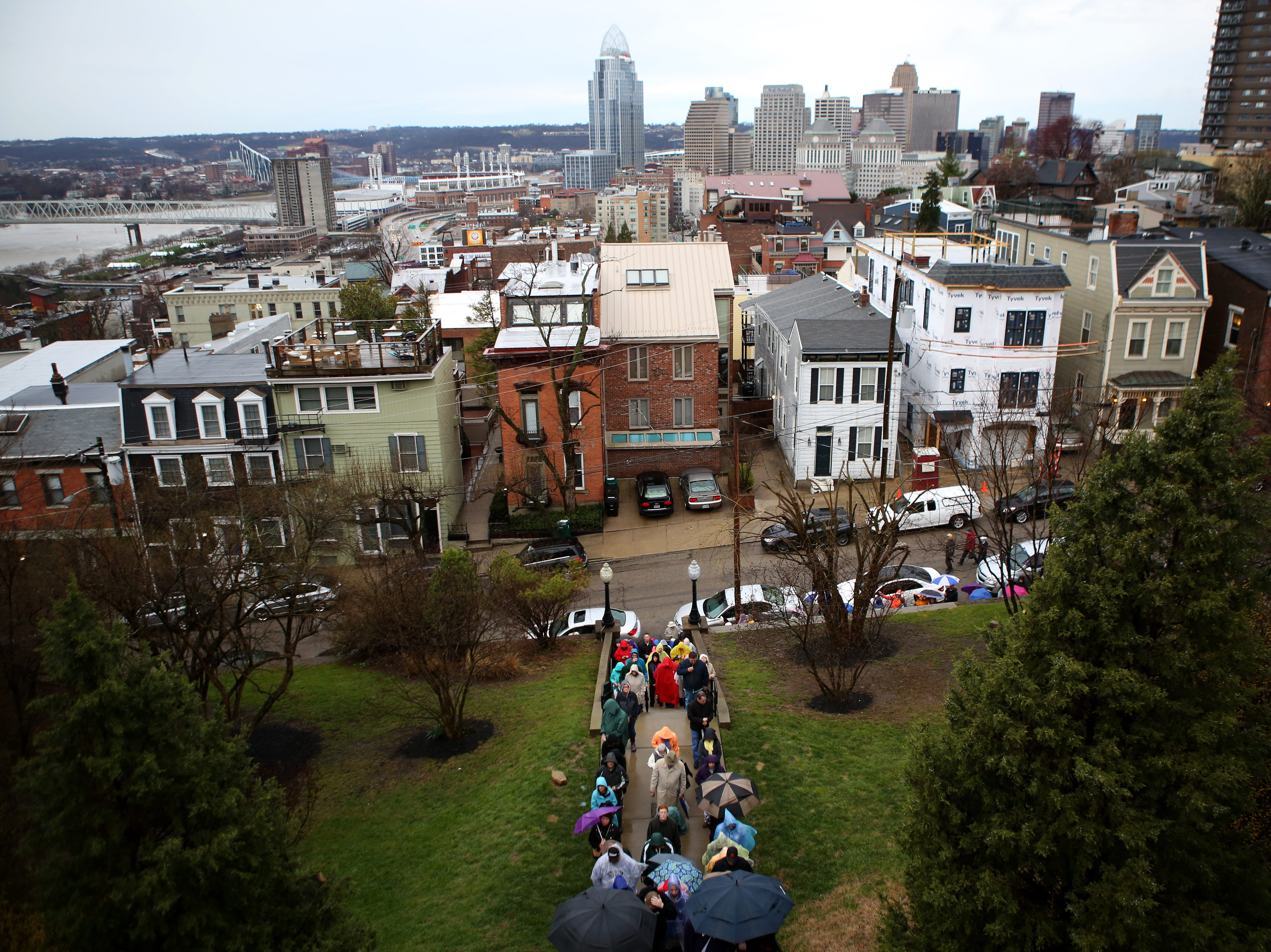 People gather this morning to pray the steps of Holy Cross Immaculata Church in Mt. Adams Friday, April 3, 2015.