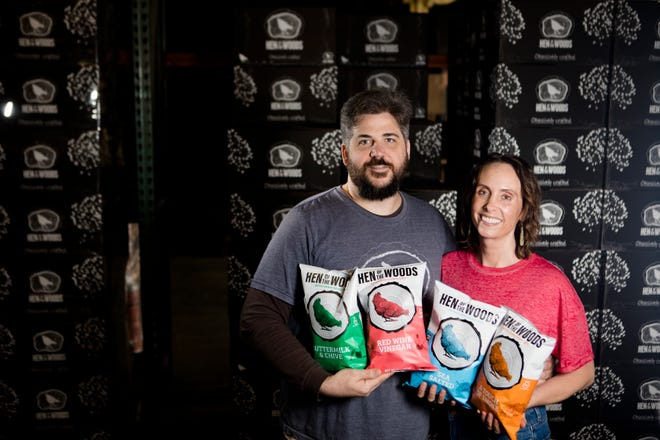 Nick Marckwald and his wife, Kimberly, owners of Hen of the Woods chips, hold bags of their chips on Monday, April 15, 2019, in Cincinnati.