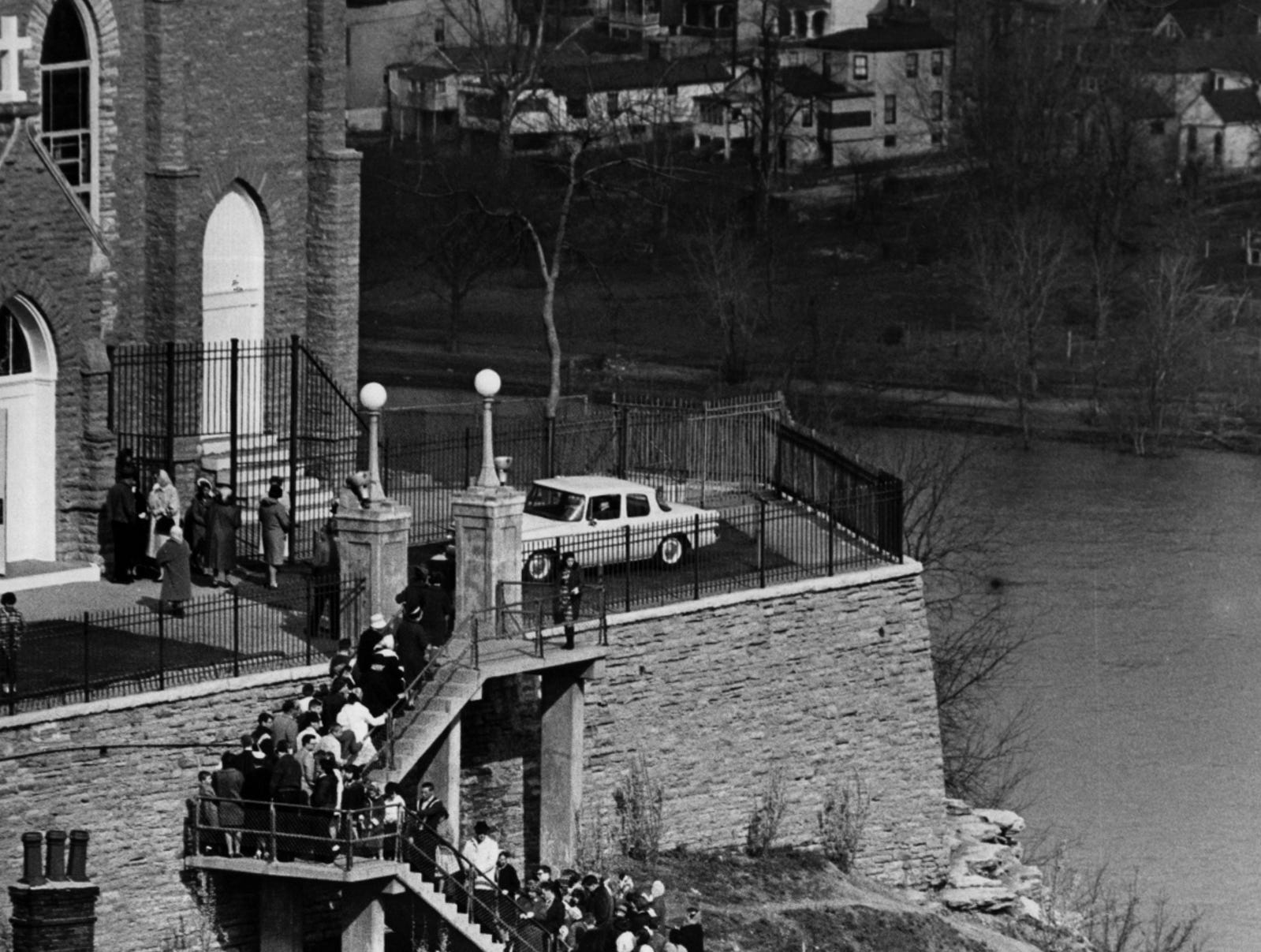 APRIL 1965: People pray the steps at Immaculata Church in Mount Adams.