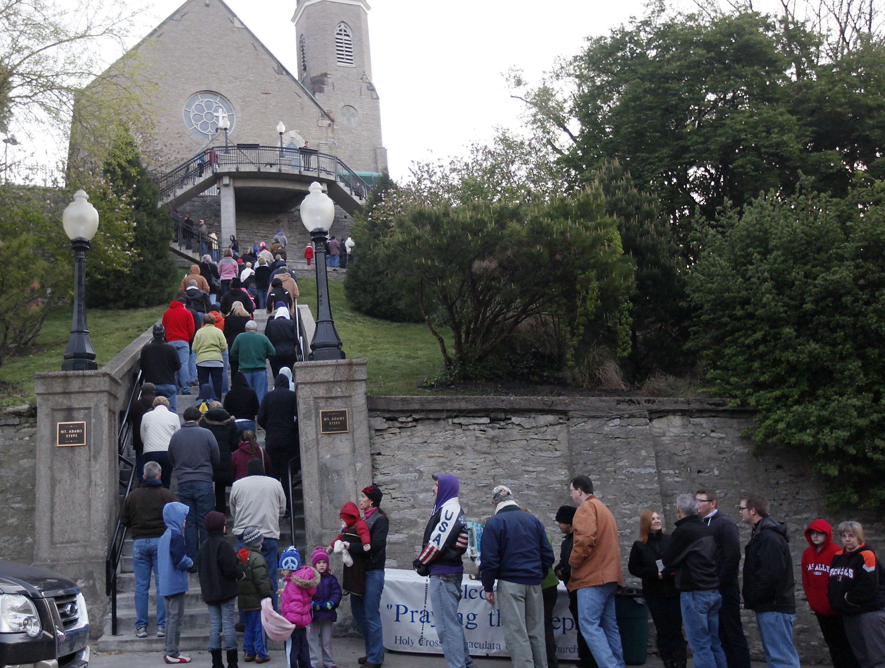 People form a line to pray the steps on Good Friday at the Holy Cross-Immaculata Church in Mount Adams on April 6, 2012.