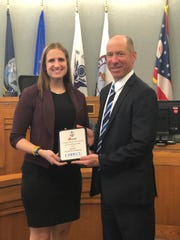 Ashley Balasko presenting Judge Greenberg with the Community Justice Award for Outstanding Judge from MADD.