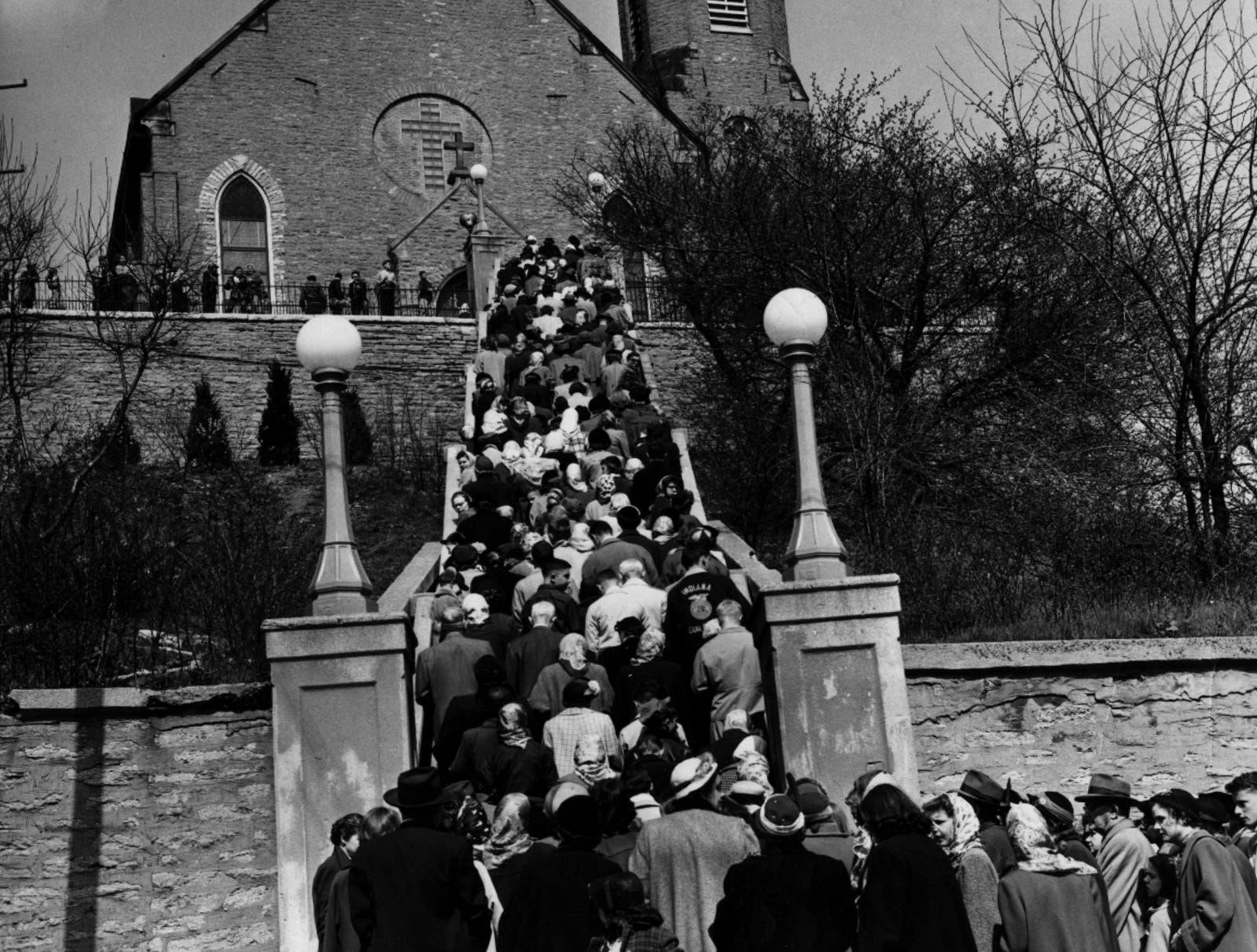 APRIL 4, 1953: People pray the steps on Good Friday at the Immaculate Conception Church in Mount Adams.