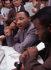 Dr. Martin Luther King Jr., attends a news conference in Birmingham, Alabama, May 9, 1963.