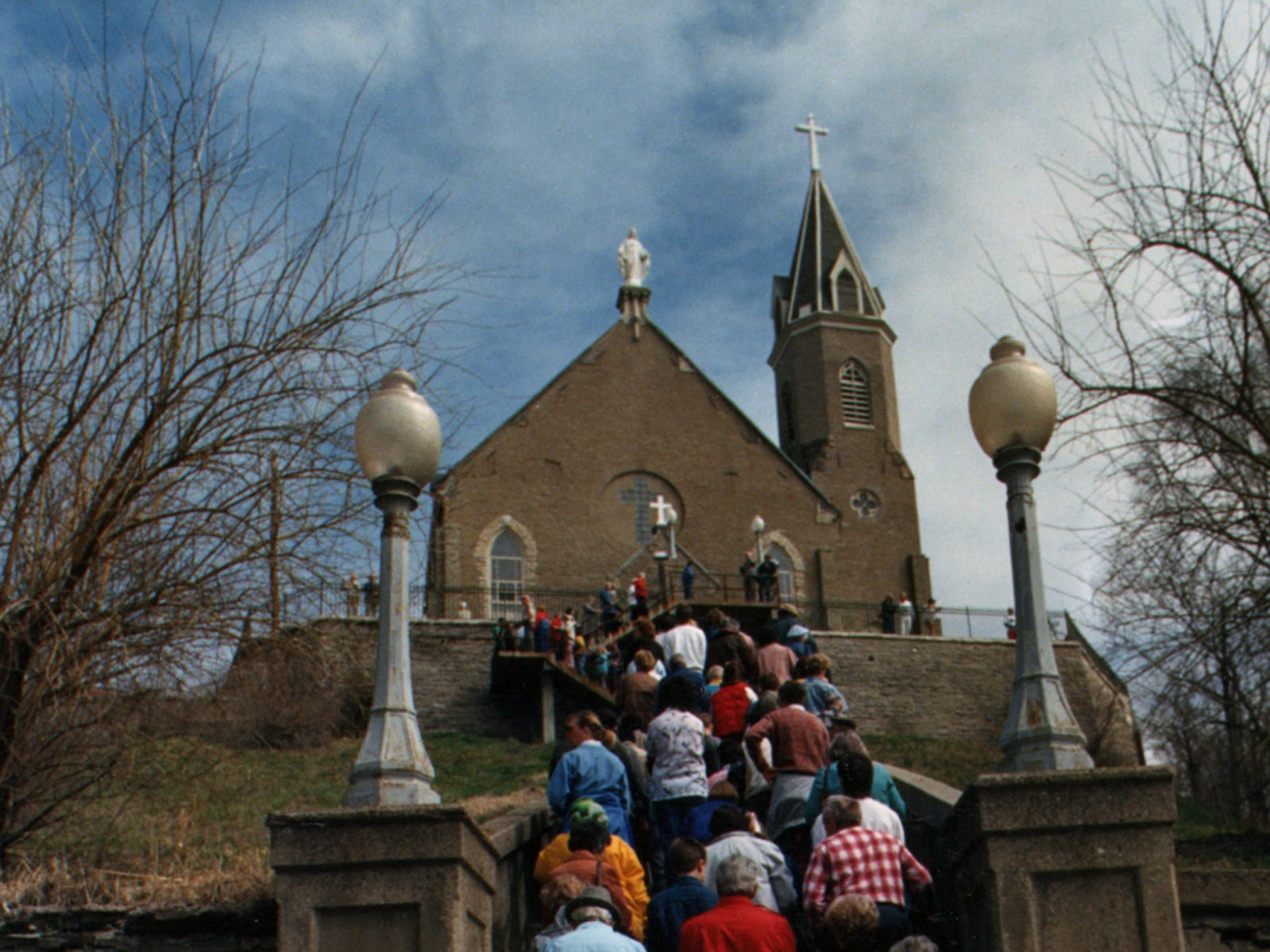 MARCH 1989: A Good Friday throng gathers on the steps of the Immaculata in Mount Adams as they prepare to continue their journey up the steps praying the rosary in the traditional Good Friday worship spot.
