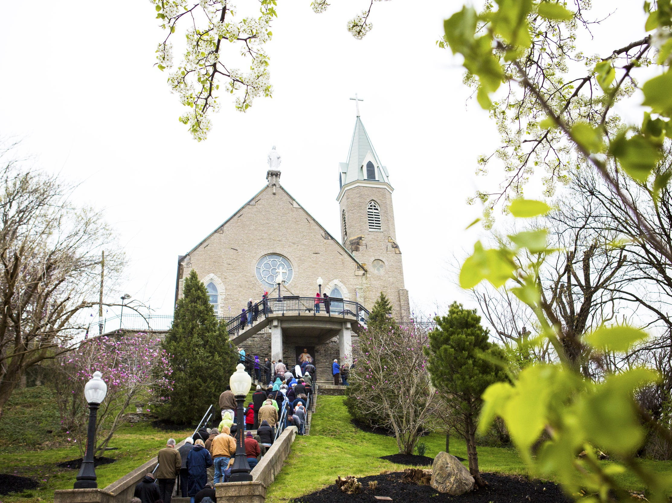Thousands gather to make their annual Good Friday pilgrimage at Holy Cross-Immaculata Church in Mount Adams Friday, March 25, 2016. This tradition is more than 150 years old.