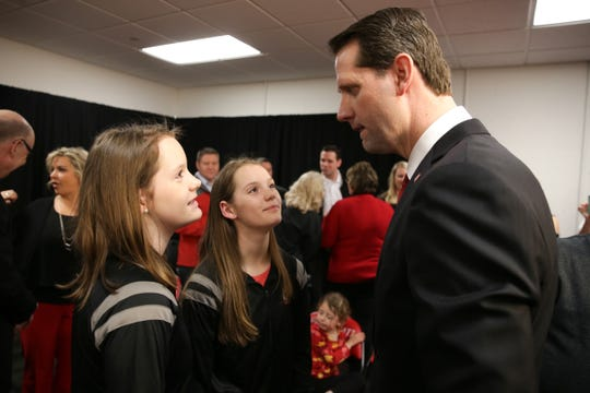John Brannen, who was introduced as men's basketball head coach at the University of Cincinnati, talks with his twin daughters, Jaylee and Katelyn, Monday, April 15, 2019, at Fifth Third Arena in Cincinnati. Brannen formerly coached at Northern Kentucky University.