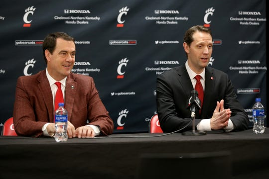 John Brannen is introduced as men's basketball head coach at the University of Cincinnati, right, along side Director of Athletics Mike Bohn, Monday, April 15, 2019, at Fifth Third Arena in Cincinnati. Brannen formerly coached at Northern Kentucky University.