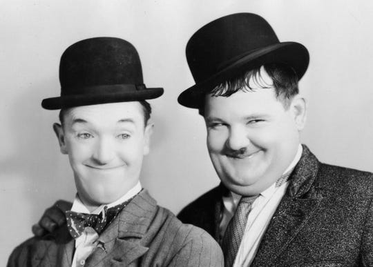Stan Laurel (left) and Oliver Hardy (right) were popular film comedians.