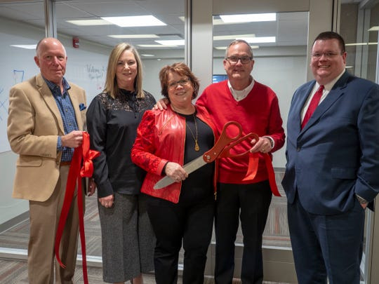 """Elberfeld and Elliott family members gathered at the ribbon cutting for the new student collaboration rooms in the UC Clermont College library named in honor of Amy Elberfeld father, W.G. """"Spud"""" Elliott. From left: Mark Elliott (Amy's brother), Kathy Elliott, Amy Elberfeld, Dave Elberfeld and son Matt Elberfeld."""