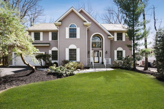 A custom built two-story, four bedroom, two full and two half bath center hall Colonial is for sale in the Farrington Lake section of North Brunswick for $585,000.