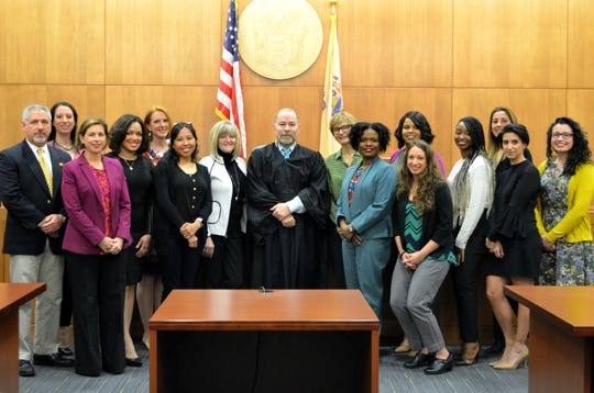 Among the newest advocates for Union County's foster youth are (from left), Stephen Wells of Westfield, Elizabeth Bennett of Rahway, Marykate La Bau of Cranford, Miozotty Diaz of Roselle Park, Lisa Betz of Summit, Andrea Balbuena of Kearny, Maryann Kaelin of Clark, Judge Richard Wischusen, Daniela Faibes of Mountainside, Hope Mitchell of Watchung, Samiyyah Muhammad of Linden, Sabrina Stein of Towaco, Nisha St. Louis of Irvington, Marcela Tricanico of Elizabeth, Kristin Steinmetz of Mountainside and Patricia Walsh of Cranford.