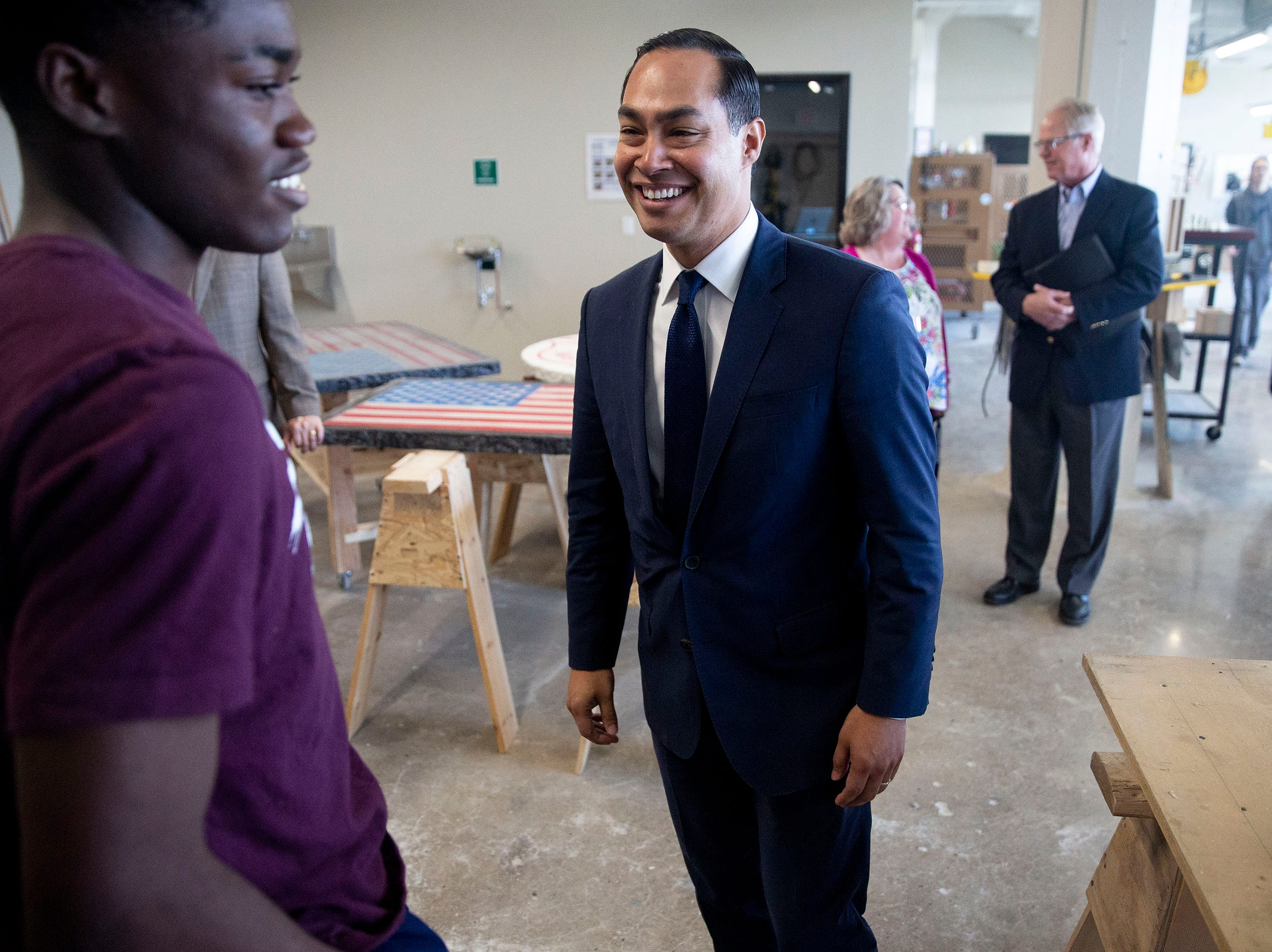 Presidential hopeful Julián Castro stops to talk with Prince Jelleh, a student at Des Moines Public Schools' Central Campus, while touring the school and the Skilled Trades Academy on Monday, April 15, 2019, in Des Moines.