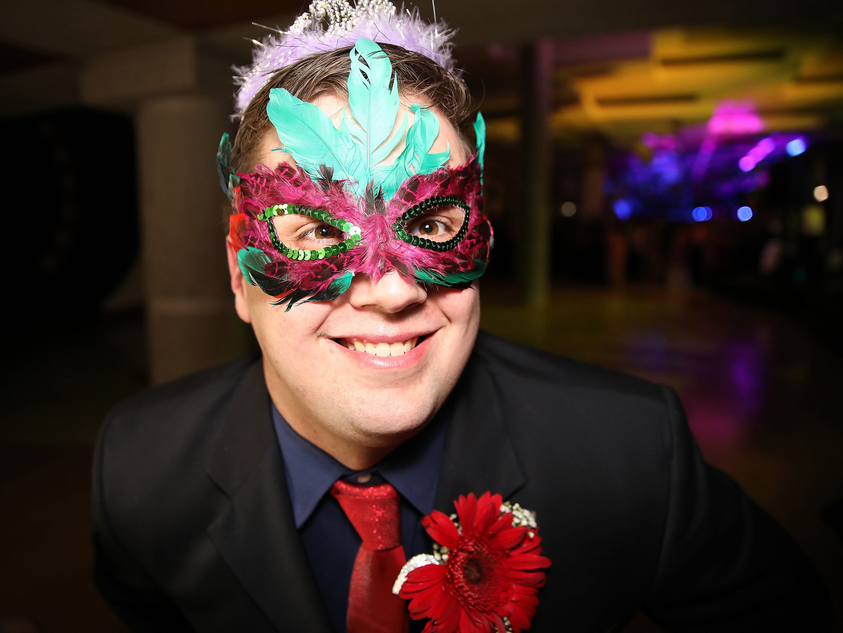Senior Griffin Sargent is the man behind the mask at the photo booth during the Ankeny Centennial High School prom at the State Historical Building in Des Moines on Saturday, April 13, 2019.