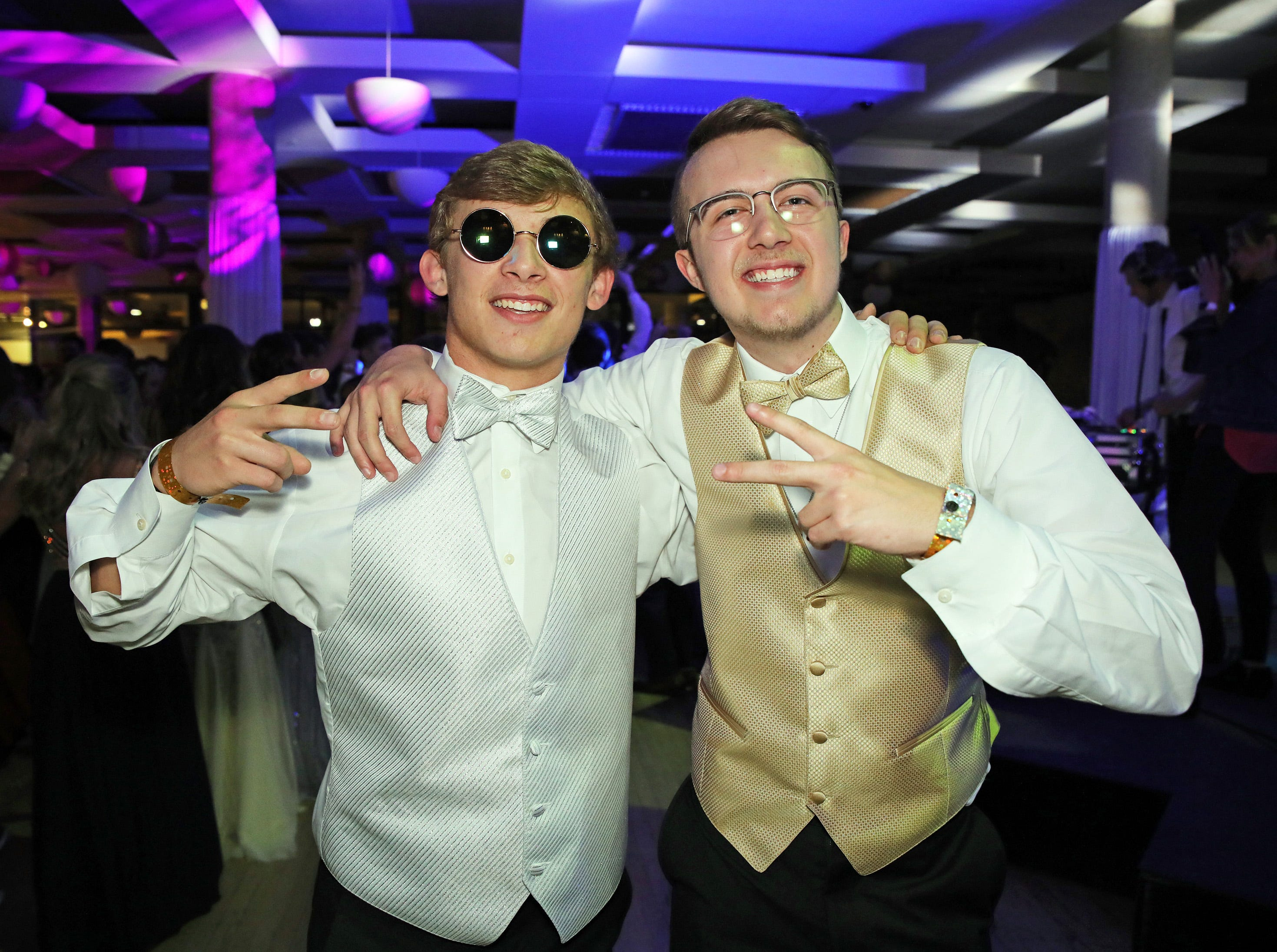 Seniors Cory Prange and Adam Robertson have fun during the Ankeny Centennial High School prom at the State Historical Building in Des Moines on Saturday, April 13, 2019.
