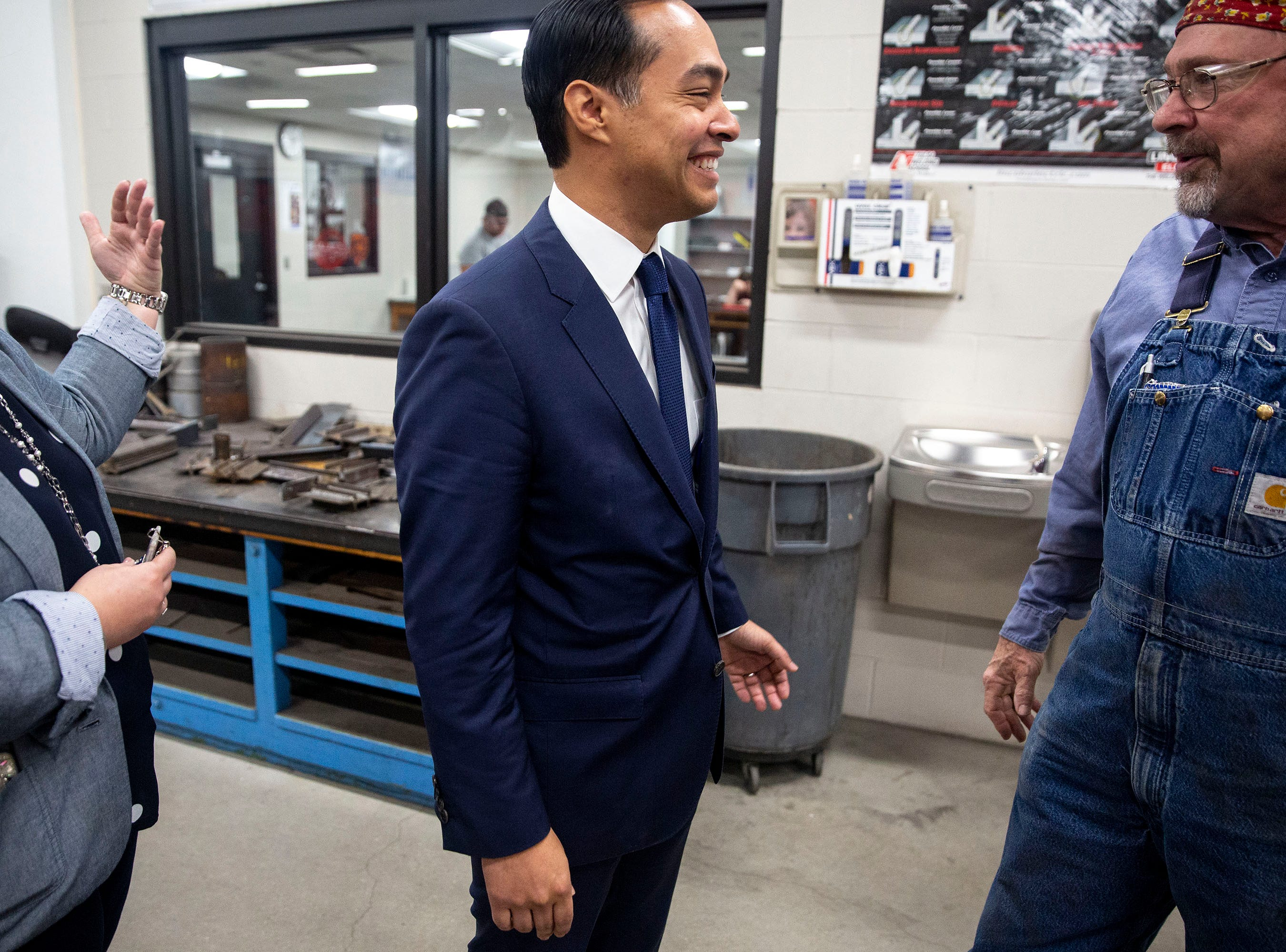 Tascha Brown, director of Des Moines Public Schools' Central Campus and welding instructor Ralph Young leads presidential hopeful Julián Castro through the welding lab of the school's skilled trades academy on Monday, April 15, 2019, in Des Moines.