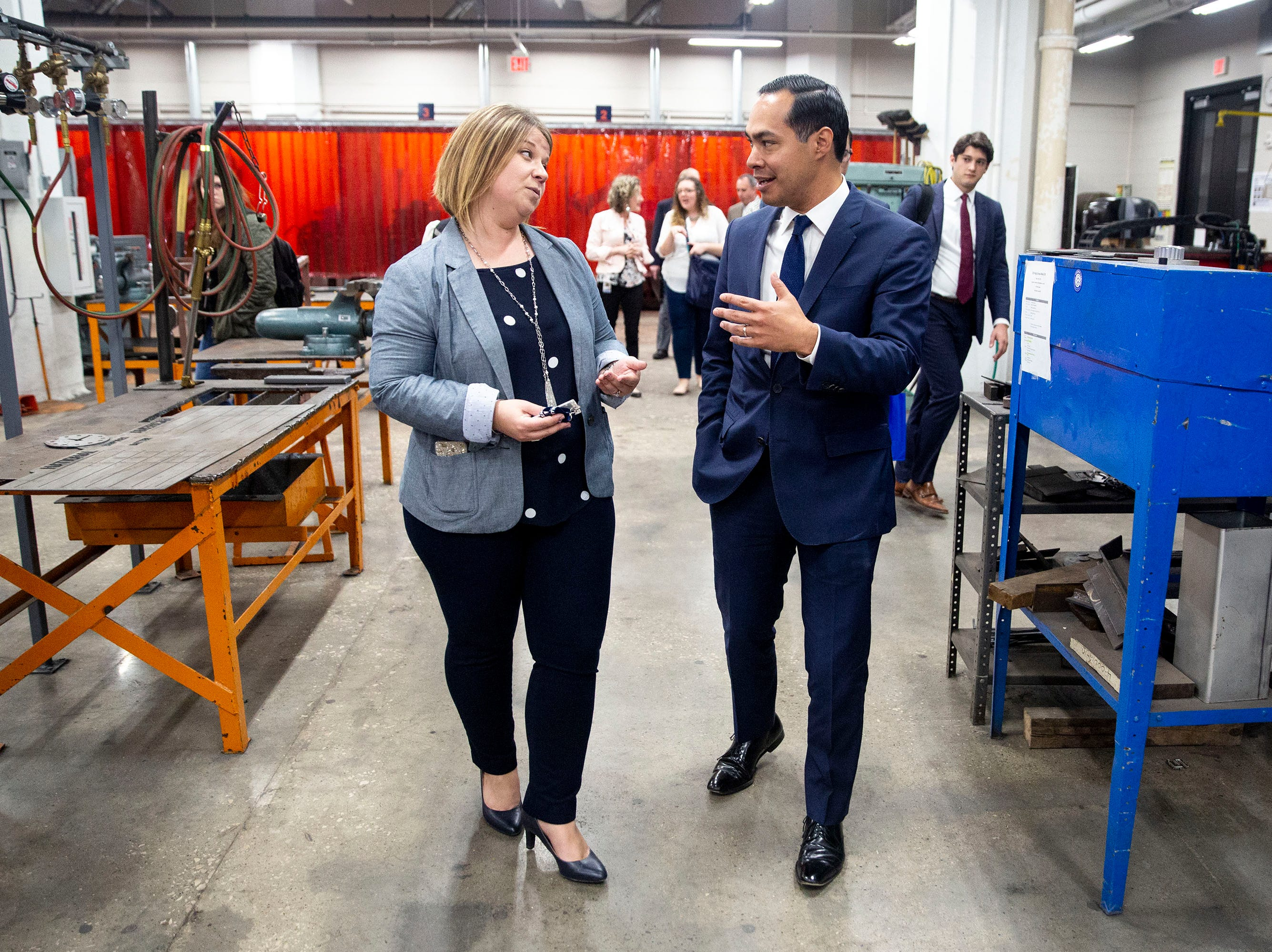 Tascha Brown, director of Des Moines Public Schools' Central Campus leads presidential hopeful Julián Castro through the welding lab of the school's skilled trades academy on Monday, April 15, 2019, in Des Moines.