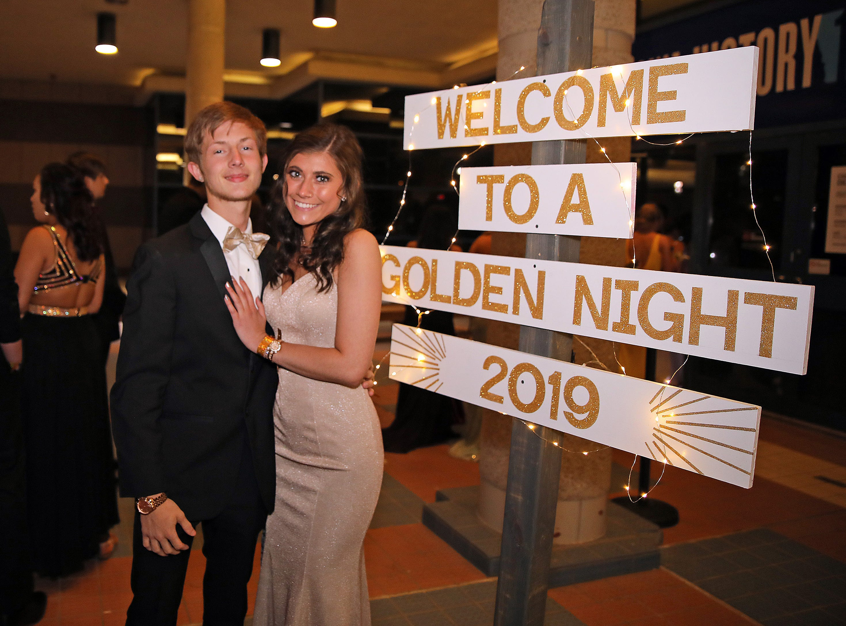 Junior Carter Dippel and senior Jinna Ashley arrive at the Ankeny Centennial High School prom at the State Historical Building in Des Moines on Saturday, April 13, 2019.