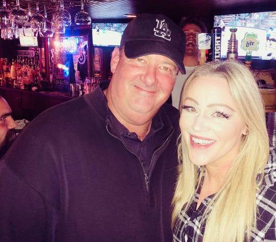 Comedian Kevin Baumgartner took a photo with Bo-James bartender Tiffany Cohen-Kniffen on Wednesday, April  10, 2019, when he visited the Iowa City bar.