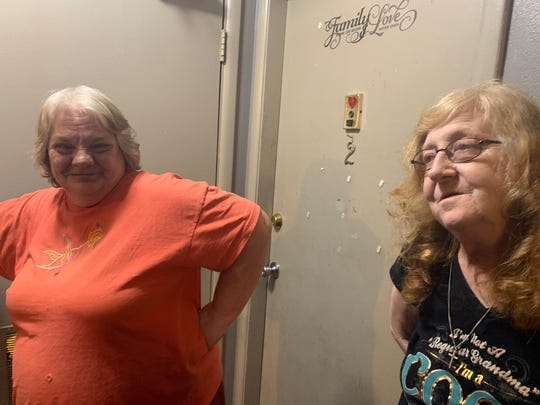 Mary Larue, left, and Mary Midthun talk about a shooting near their apartment building they in on East 26th Steet.