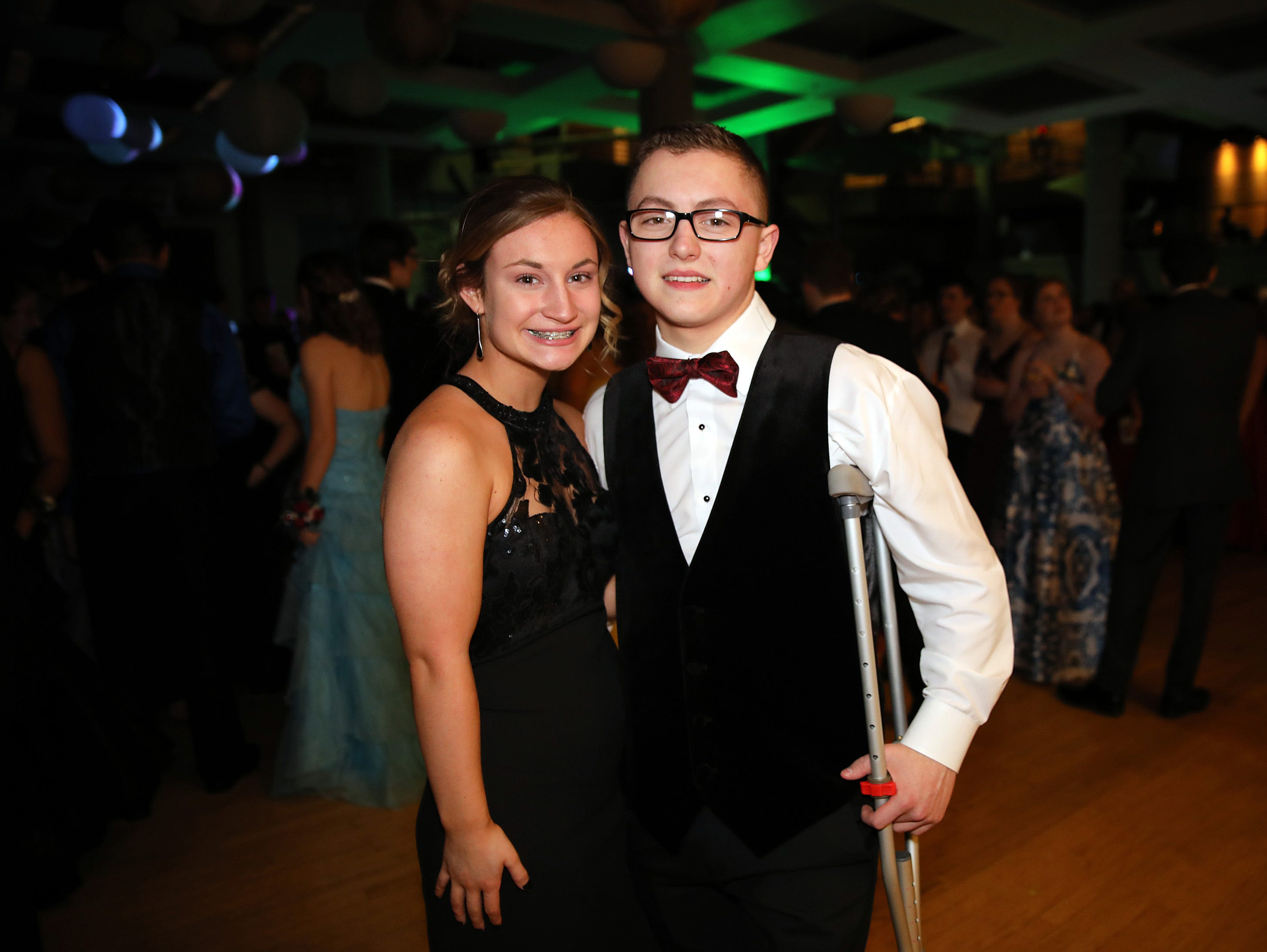 Sophomore Catalina Wiedershott and junior Ian Puentes attend the Ankeny Centennial High School prom at the State Historical Building in Des Moines on Saturday, April 13, 2019.