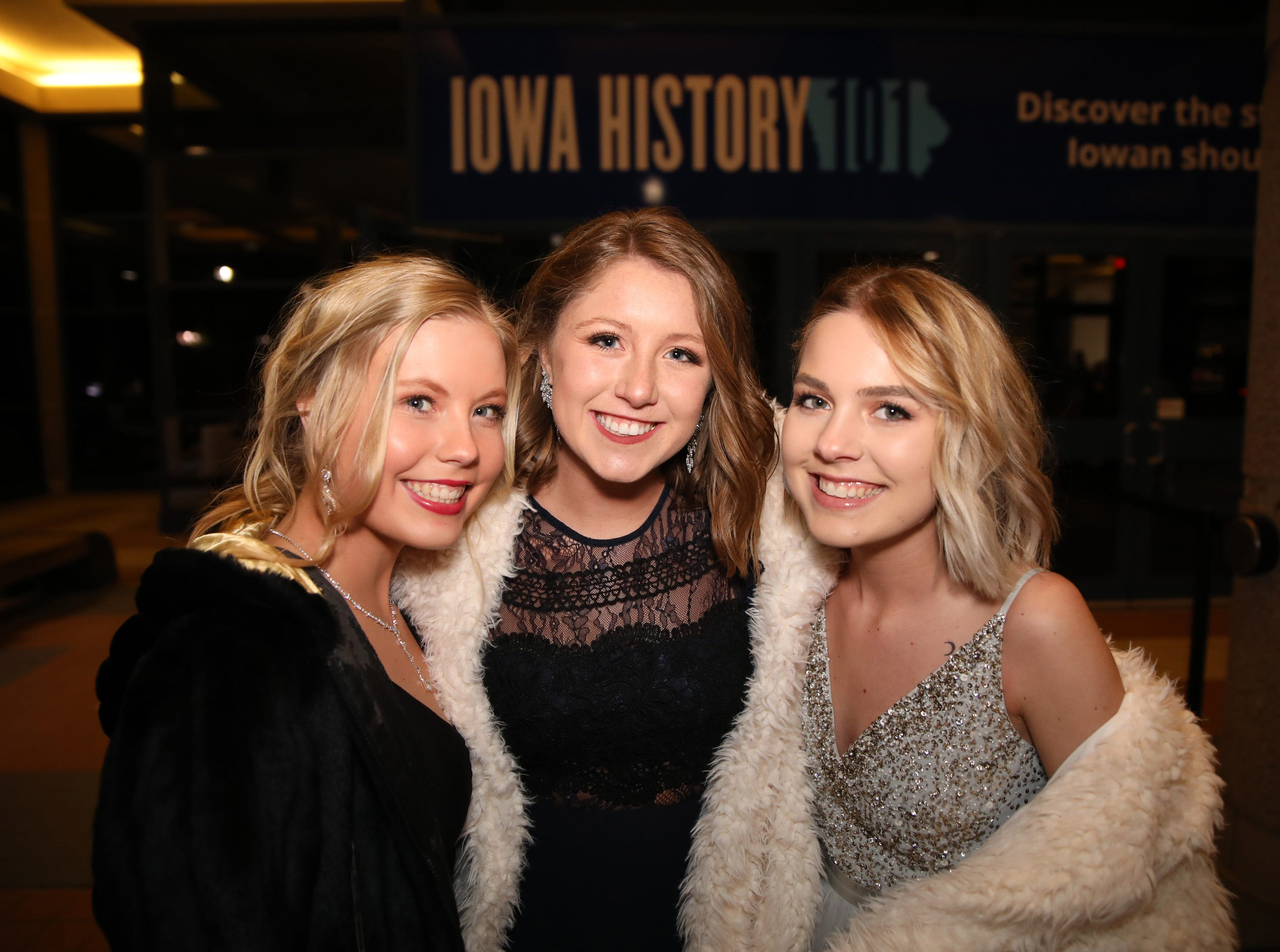 From left, seniors Rachel Ryan, Alia Smith and Ellie Backes arrive at the Ankeny Centennial High School prom at the State Historical Building in Des Moines on Saturday, April 13, 2019.
