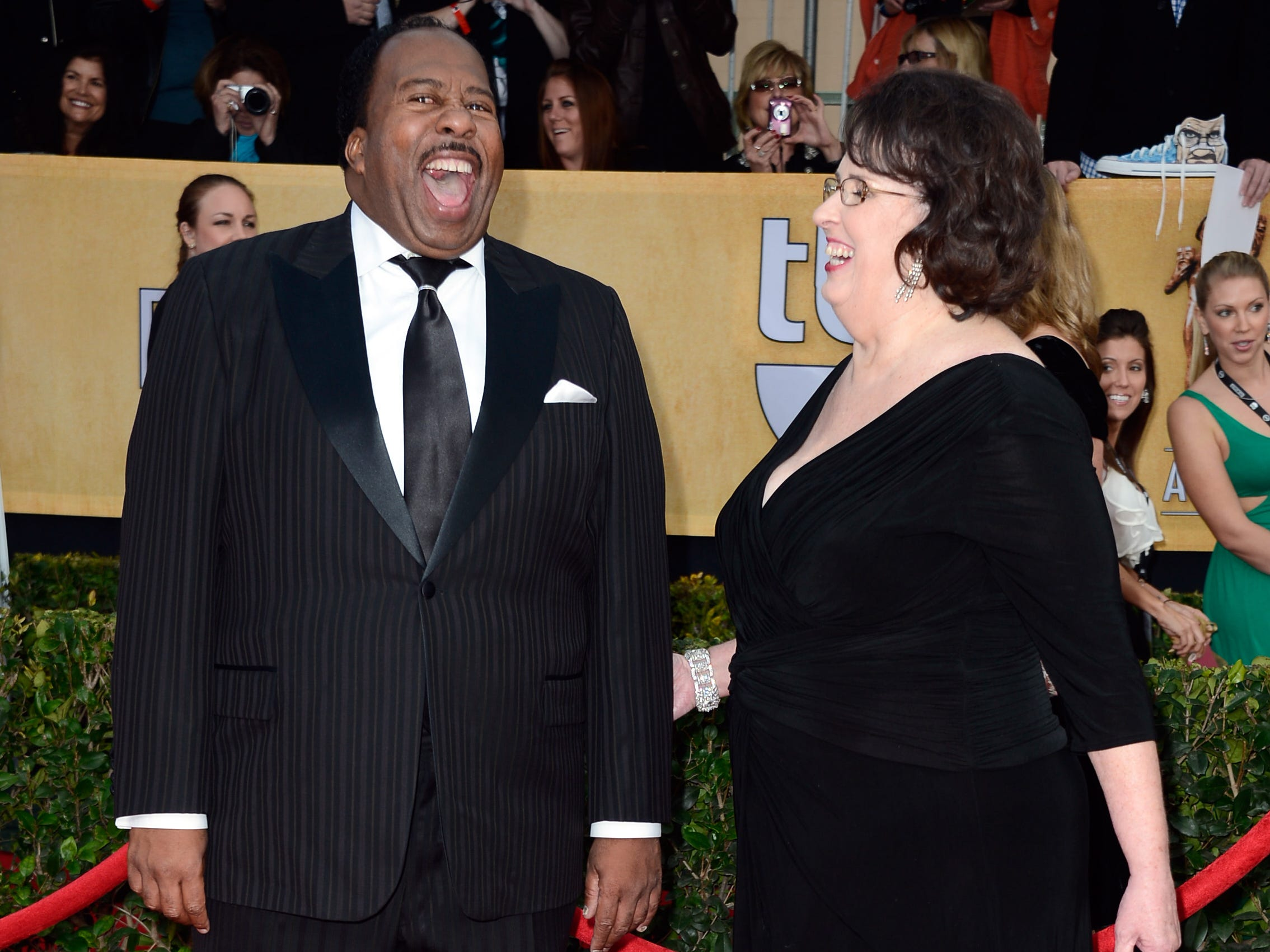 """Actors Leslie David Baker, left, and Phyllis Smith arrive at the 19th Annual Screen Actors Guild Awards held at The Shrine Auditorium on January 27, 2013 in Los Angeles, California. Baker played Stanley on NBC's """"The Office"""" and Smith played Phyllis."""