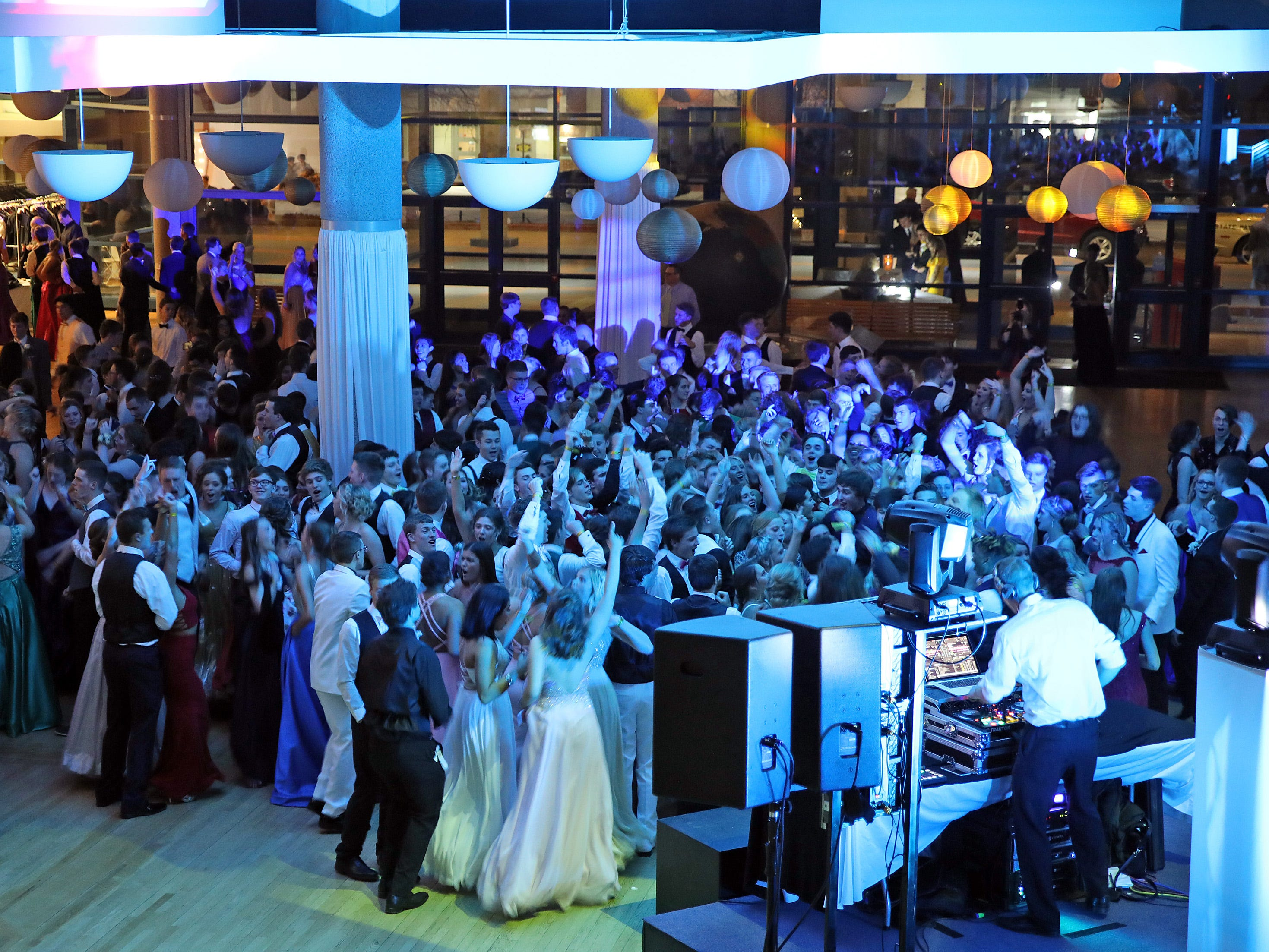 Centennial students hit the dance floor during the Ankeny Centennial High School prom at the State Historical Building in Des Moines on Saturday, April 13, 2019.